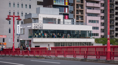 Tokyo, Japan - May 4, 2017: Tourists are lining up waiting to get on the Tokyo Water Bus.
