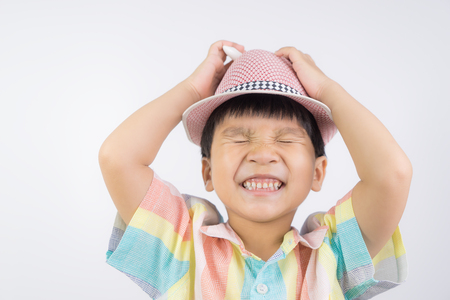 Asian boy wearing hat is having a stressed out