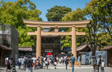 Tokyo, Japan - May 5, 2017: People are traveling in to Meiji Shrine through the wooden gate. Editorial