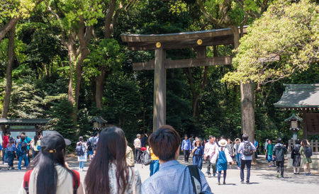 Tokyo, Japan - May 5, 2017:  Tourists are entering Meiji shrine through the giant wooden gate. Editorial