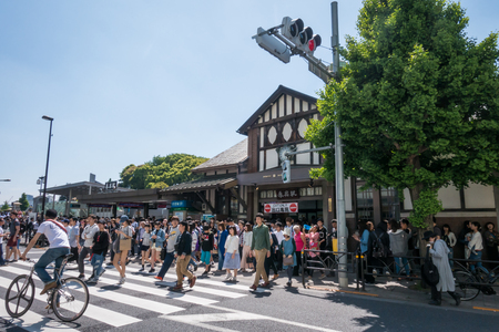 Tokyo, Japan - May 5, 2017:  Large crowd of people walking out of Harajuku station in golden week.