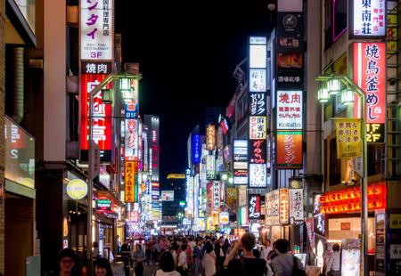 Tokyo, Japan - May 5, 2017:  Advertising signages lighten up at night in Shinjuku street.