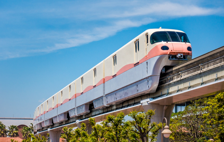 High tech monorail is moving on track under blue sky Stock Photo