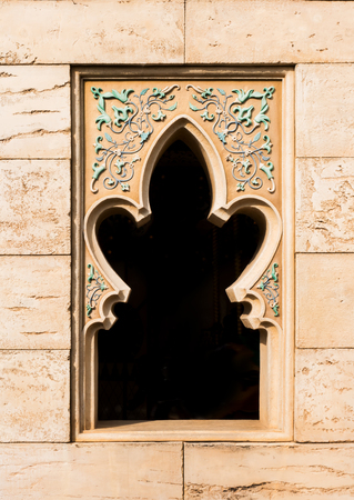 Arabian style window on brown brick wall