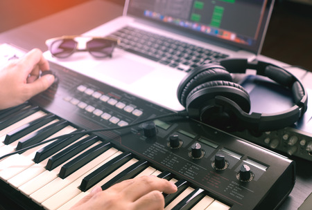 Music Producer is recording Music onto a laptop Stok Fotoğraf