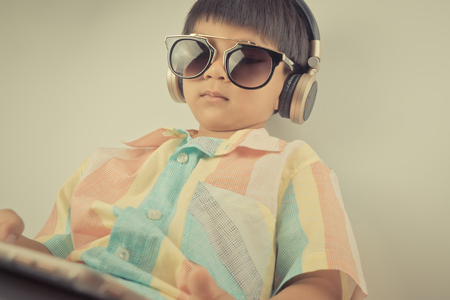 boy is watching movie on headphone and tablet Stock Photo