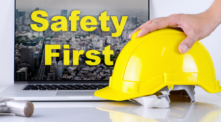 Engineer is picking up safety helmet for Safety First Concept