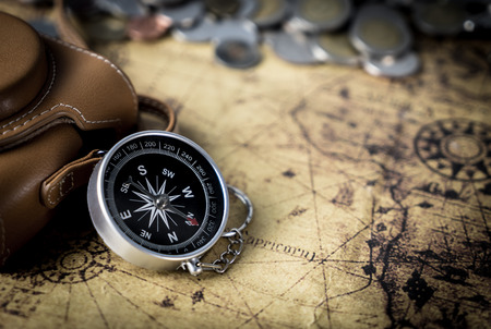 Compass and camera on vintage map copy space Stok Fotoğraf
