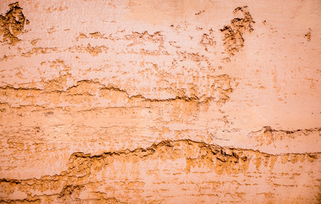 Cracked orange clay wall for texture and background 版權商用圖片