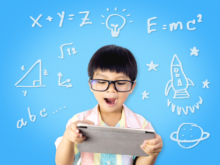 Nerdy Kid is getting Education from Internet tablet