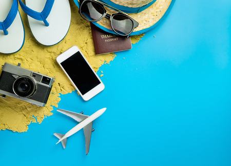 wooden floors: Beach Summer Vacation travel accessories and fashion on Sand and blue background. Stock Photo