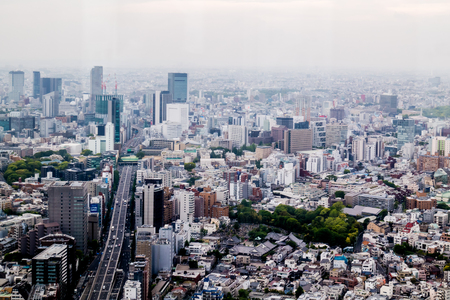 Tokyo, Japan - May 7, 2017: Tokyo Commercial buildings city scape from aerial view.