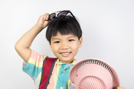 Asian kid is getting dressed up in summer clothing for summer Vacation isolated on white Stock Photo - 80678779