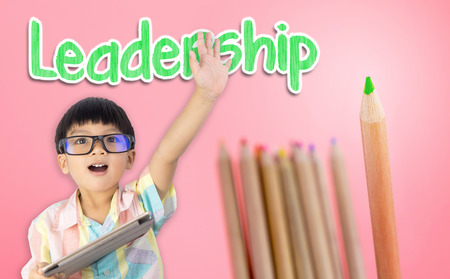 Boy raising his hand ready for leadership Stok Fotoğraf