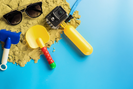 Summer Beach travel toy and gadgets on blue copy space