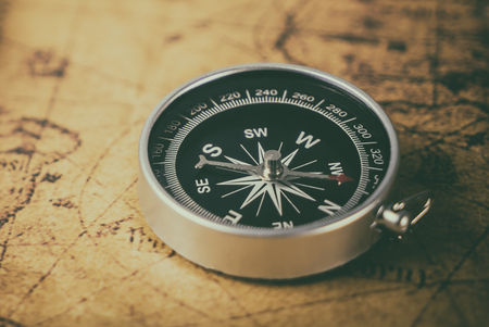 Vintage compass on retro map for explorer concept Stock Photo - 81544589