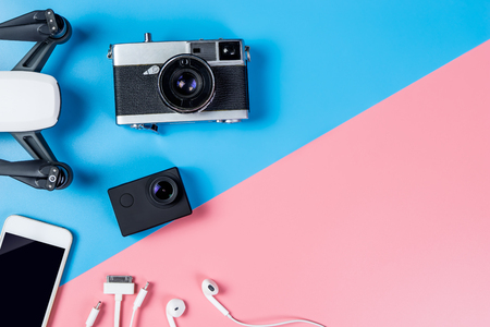 Hi tech travel gadget and accessories on blue and pink copy space Reklamní fotografie