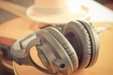 Country acoustic Guitar with hat and headphone Stock Photo