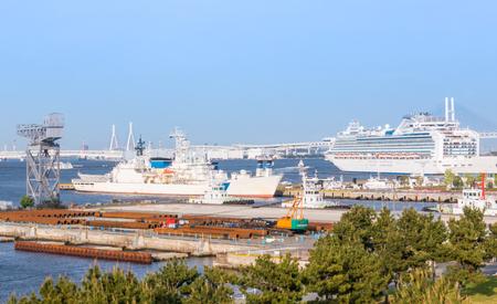 Battle ship and cruise ship docking in Yokohama bay Stock Photo
