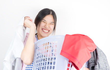 Women is happily cleaning up the laundry