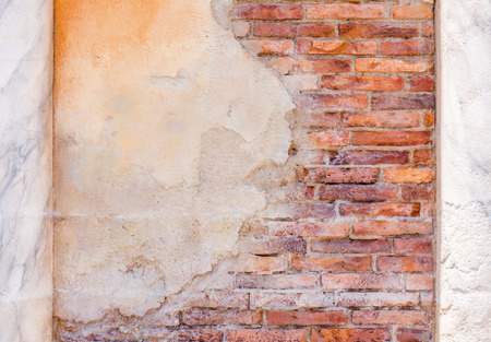 Cracked concrete wall with red brick texture Stock Photo