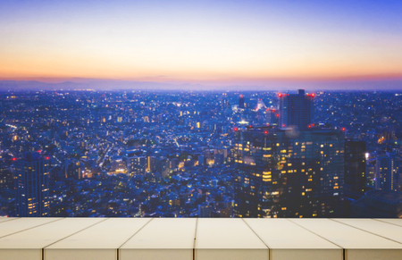 White wooden counter with tokyo city background at night Stock Photo