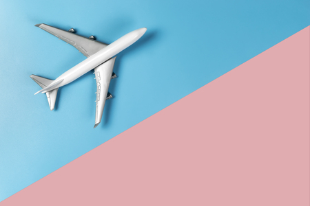 Toy plane on blue and pink copy space