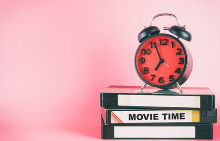 Video tape and Alarm clock lable movie time
