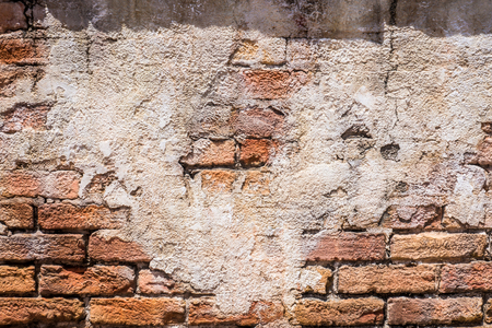 Cracked concrete wall with red brick texture Stok Fotoğraf