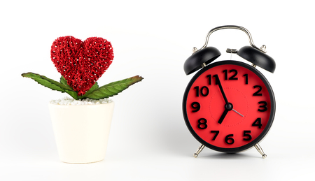 Love take time concept with heart flower and alarm clock