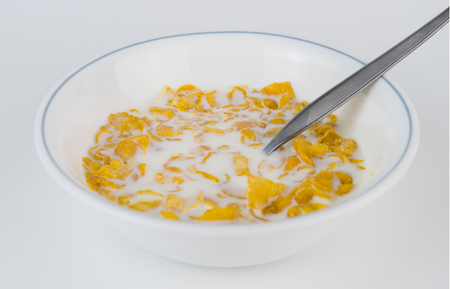Cornflake with milk on bowl isolated on white Stock Photo