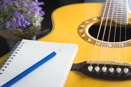 Blank notebook on guitar for song writer 版權商用圖片
