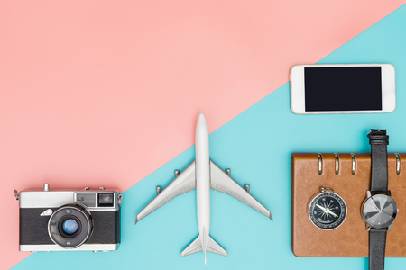 Travel Flat Lay object on blue and pink copy space