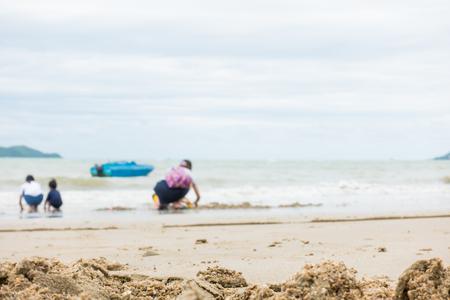 Asian family is playing on a sand beach Фото со стока - 82354035