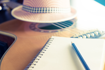 Blank notebook on guitar for songwriter 版權商用圖片