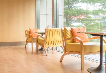 Orange tone bright cafe restaurant seating area.