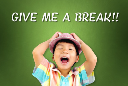 Little boy screaming out for Give Me A Break Stock Photo