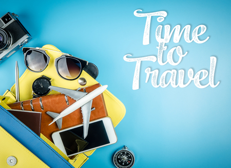 Women travel accessories out of a hand bag for travel time