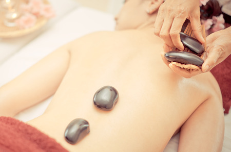 energy healing: Women is getting thai style hot stone Spa treatment