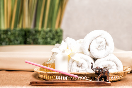 Thai Spa Towel and product in wooden basket
