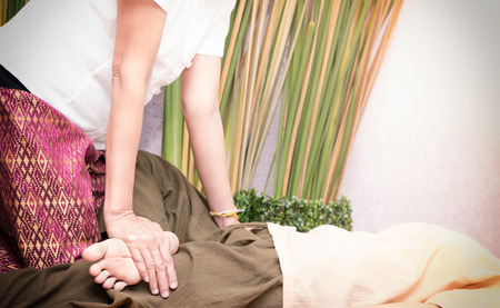 Therpist is giving a leg stretching massage in a spa