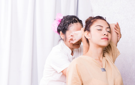 Therapist is stretching arm of a women in Thai massage course 版權商用圖片