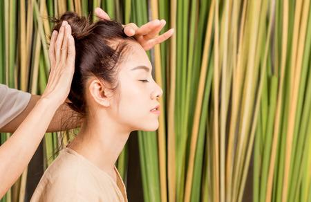 Women is having head massage relaxation on tree background Stock Photo