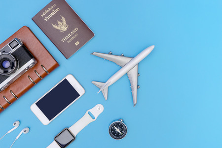 Travel object and accessories on blue copy space
