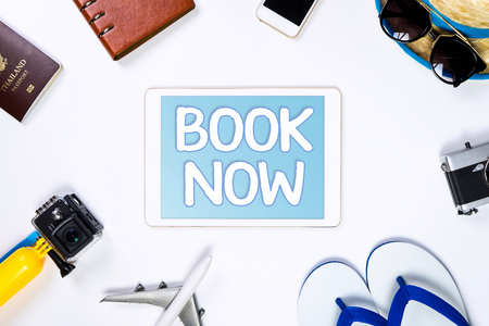 Travel book online now on tablet for online travel agency concept Stok Fotoğraf