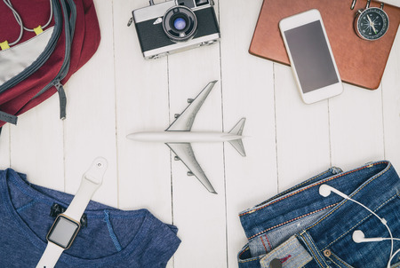 Travel fashion and accessories flat lay on white wood Reklamní fotografie