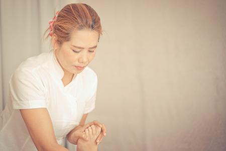 Thai massage therapist is massaging feet Stock Photo