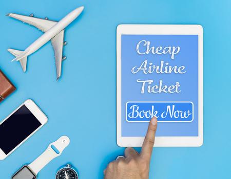 格安航空券は、タブレットのボタンをクリックします。