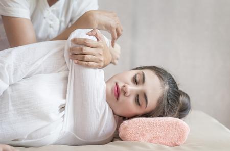Women is getting arm massage by Thai massage Therapist
