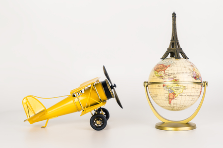 trip over: Toy metal plane traveling to Eiffel tower on the top of the world